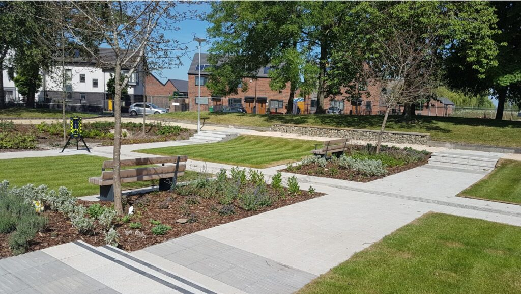Thumbnail of http://Path%20through%20grass%20and%20planting%20in%20new%20park